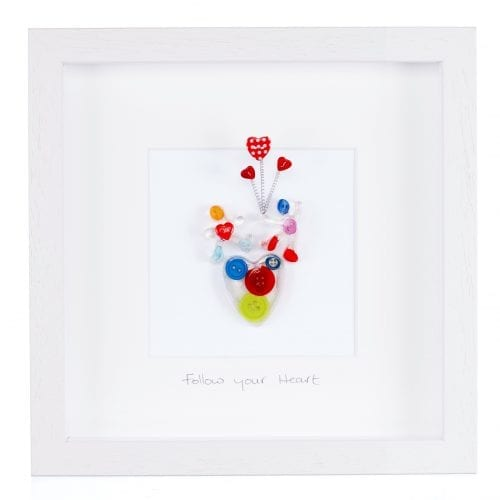 wall art made from buttons and resin with inspiring quote follow your heart