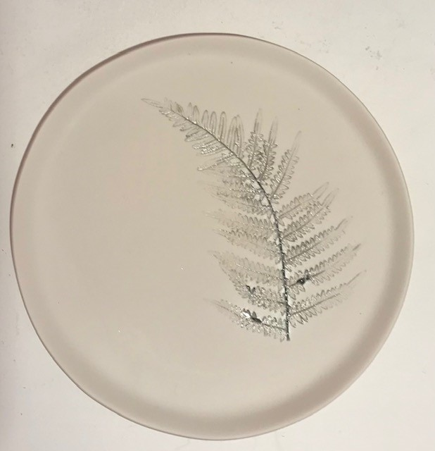 Ceramic plate with impressed fern