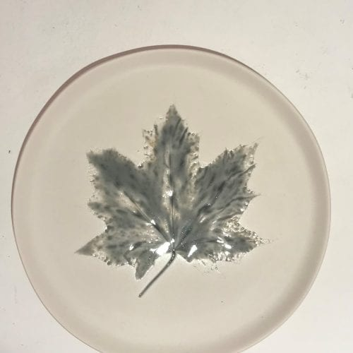 round ceramic plate with impressed leaf detail