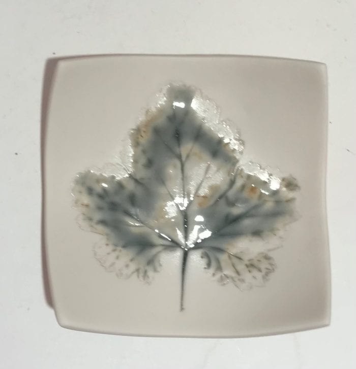 small handmade ceramic dish with Impressed leaf detail