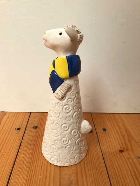 Handmade standing ceramic sheep with blue and yellow coloured scarf