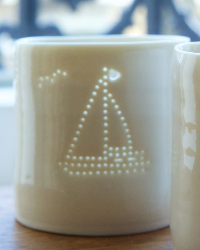 porcelain tealight holder with sailboat cut out....