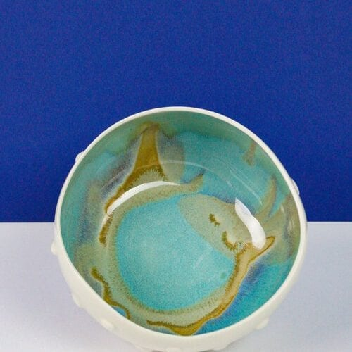 handmade-porcelain-bowl-with swirling-turquoise and gold interior