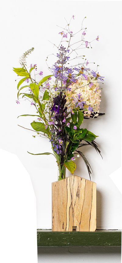 Glass_tube_in_a_wooden_house_for_Flowers