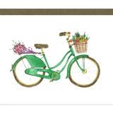 green bike with flowers in the basket and on the back