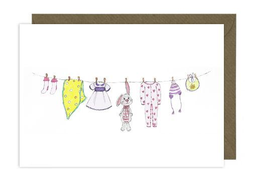 new baby card with illustration of baby clothes hanging on the line