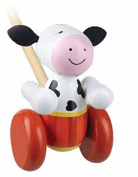 wooden child's learning to walk toy with red wheels, wooden handle and face of a smiling cow