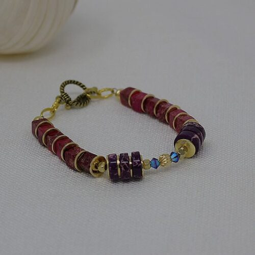image of bracelet made from pink and purple stones and swarovski crystals by KKajoux